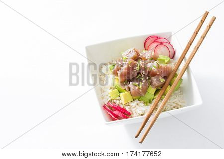 Hawaiian tuna poke bowl with avocado, radishes and sesame seeds, isolated on white background