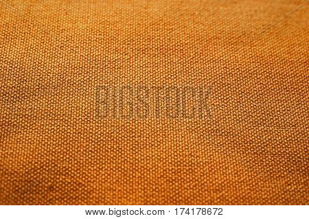 Orange fabric texture. Orange cloth background. Close up view of orange fabric texture and background. Abstract background and texture for designers. Orange texture.