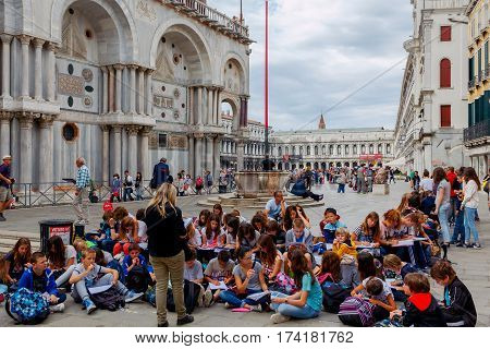 Italy, Venice - 20 May, 2015: Venice. Group of students with teacher on the square of St. Mark. The most visited places in Venice.