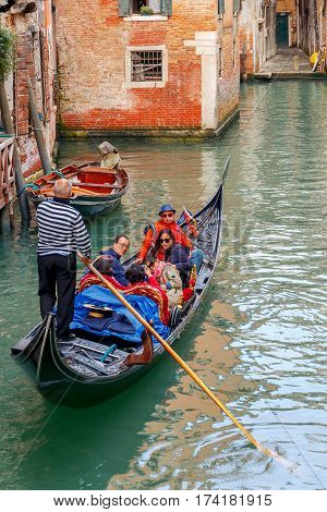 Italy, Venice - 23 May, 2015: Venice. A gondola ride along the canals of Venice. The most popular tourist attraction.