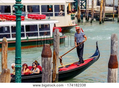 Italy, Venice - 25 May, 2015: Venice. A gondola ride along the canals of Venice. The most popular tourist attraction.