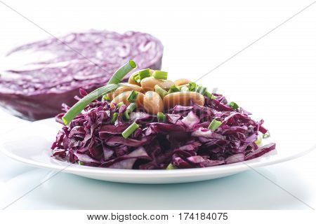 fresh salad of red cabbage with boiled beans on a plate