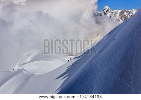 Climbers on the Mont Blanc massif. View from Aiguille du Midi Mount 3842 m France