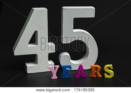 Figures and year on a black background.