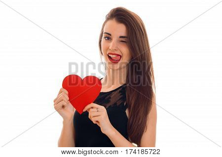 beautiful girl with red lipstick on lips holding a postcard sweetheart and winks isolated on white background