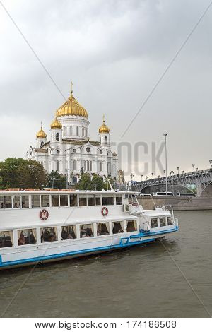 Pleasure boat on the Moscow river in rainy weather.