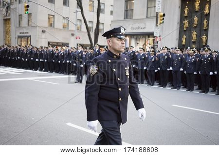 NEW YORK - JAN 13 2017: NYPD Det. Steven McDonald funeral procession and service at St Patricks Cathedral, 5th Avenue, Manhattan - Law enforcement personnel line 5th Ave.