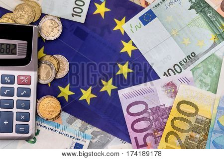 Calculator With The European Flag On The Background Of The Euro