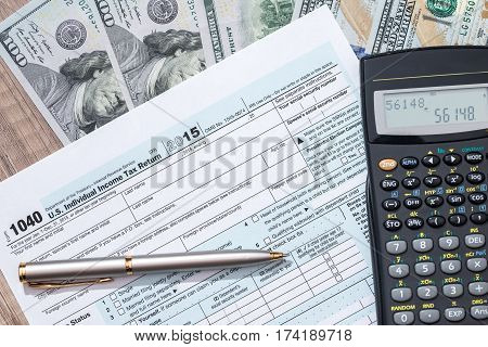 Federal Income Tax Return 1040 Documents With Pen, Calculator, Dollars