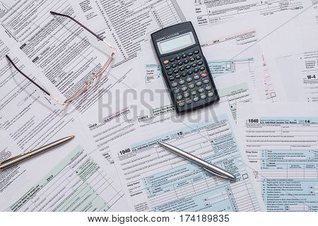 us tax form with calculator close up