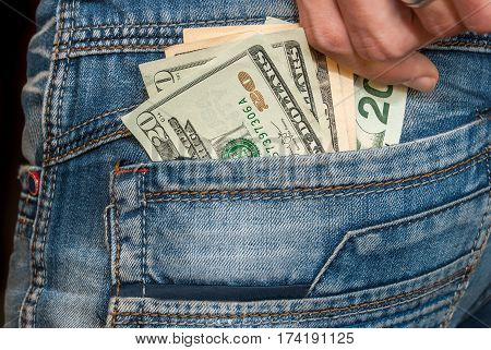 Male Hand With Dollars In The Pocket
