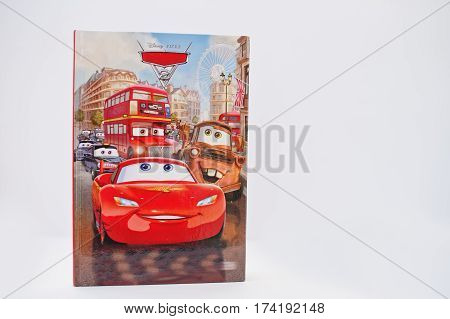 Hai, Ukraine - February 28, 2017: Animated Disney Pixar Movies Cartoon Production Book Cars2 On Whit