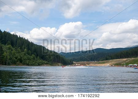 View Of The Blue Lake In The Highlands. Ukrainian Carpathians. Bukovel