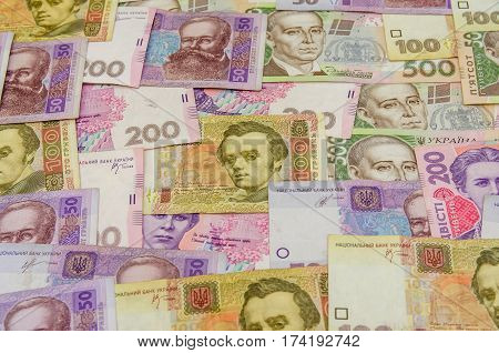 different ukrainian banknotes background close up 100 200 500