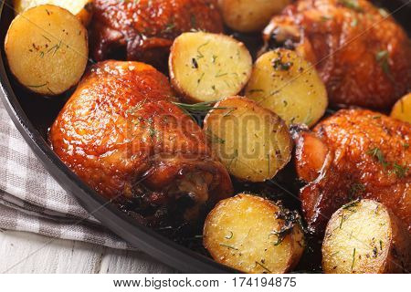 Delicious Maple Chicken Thighs And Baby Potatoes Close-up. Horizontal