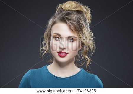 Portrait of Blond Caucasian Woman Posing Against Gray Background.Tranquil Expression.Horizontal Image Composition