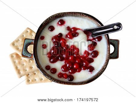 Top view of sweet semolina with berries and crackers for Breakfast.  Porridge with cowberry in a ceramic bowl. Isolated on white background. Horizontal location.