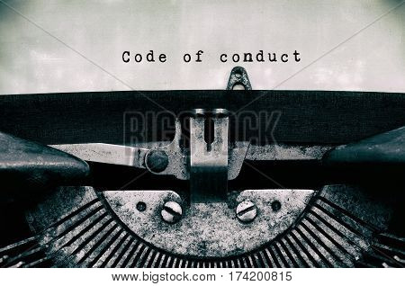 Code Of Conduct Words Typed On A Vintage Typewriter In Black And White.