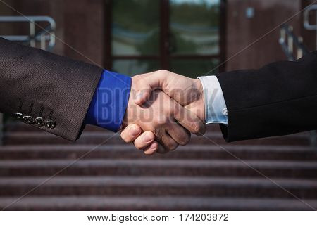 Business handshake agreement. Handshake on background Bank. Shake hands with each other. Friendship partners handshake. Business handshake concept