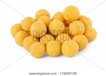 Yellow boilies carp fishing baits isolated on white background with soft shadow
