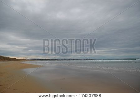 Dramatic soft grey clouds above a deserted beach in Fraserburgh, Scotland