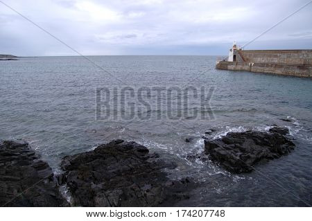 Whitehills' Harbour and a rocky sea, Aberdeenshire