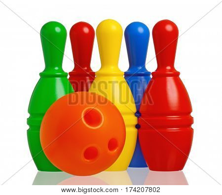 Colorful plastic toy bowling with orange ball isolated on a white background