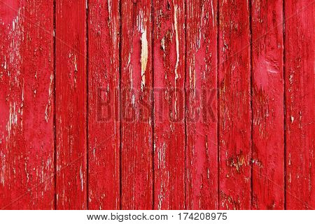 Fragment of red painted threadbare wooden wall