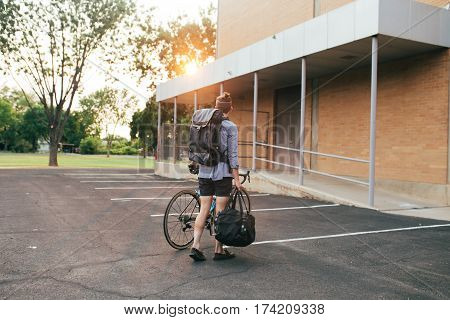 A cyclist taking his bags and a bike to the motel