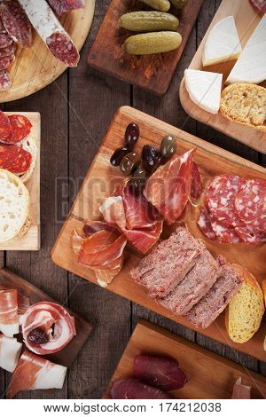 Charcuterie board with cured meats , bread and olives