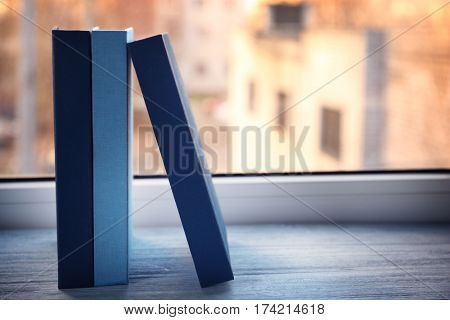 Hardcover books on windowsill, closeup