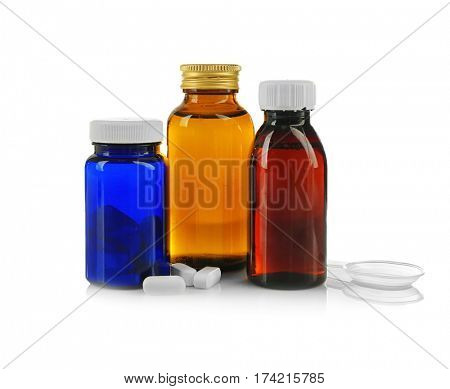 Bottles with cough syrup and pills isolated on white