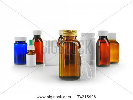 Bottle with cough syrup and medicines isolated on white