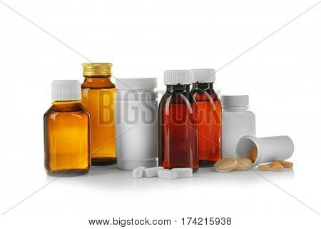Bottles with cough syrup, pills and medicines isolated on white