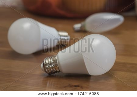 Light bulbs with frosted glass on a brown table