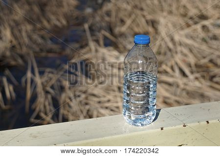 Water Bottles On A Background Of Blurred Canes