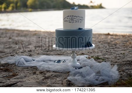 wedding cake on the beach at sunset