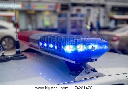 The roof-mounted activated lightbar of police vehicle