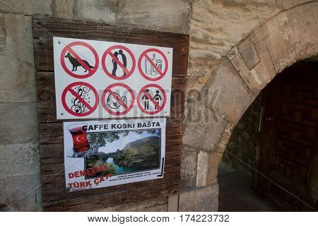 Mostar, Bosnia and Hercegovina, circa july 2016: Forbidden sign at the entrance of the mosque in Mostar