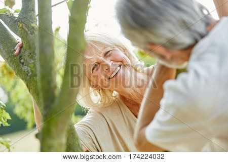 Happy senior couple dating and flirting in summer in the nature