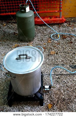 Gas Bottle And Pot In The Kitchen For Food Preparation When Camp
