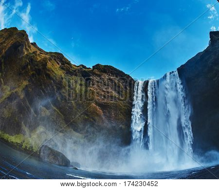 famous Skogarfoss waterfall in southern Iceland. treking in Iceland. Travel and landscape photography concept