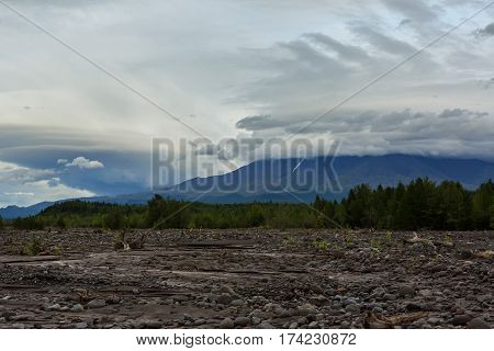 View of the volcano Ostry Tolbachik from river Studenaya at dawn. Kamchatka Peninsula.