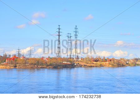 Power line and Neva River at early spring on the outskirts of St. Petersburg Russia.
