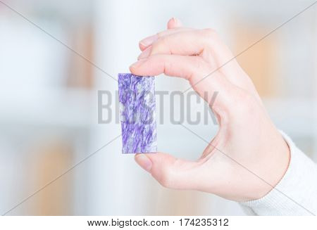 Charoite rare preciouse gemstone in hand