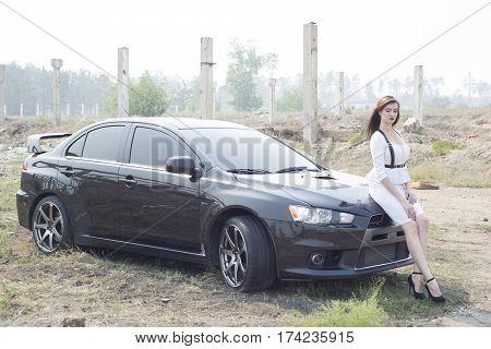 Beautiful Girl Detective Near The Sports Car.