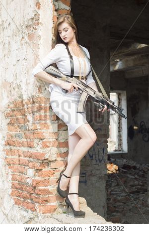 Beautiful Girl Bodyguard With A Gun In His Hand.