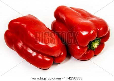 Fresh red pepper on white background, Isolated red peppers, Raw peppers, Vegetarian food pepper,