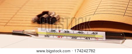 Mercury thermometer and pills medicines to medical card medicine