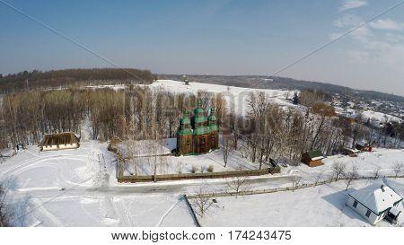Traditional Ukrainian village in winter, Pirogovo, aerial view